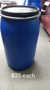 Large 55 gallon plastic barrels perfect for shipping or storage