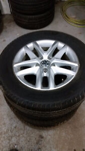 215 65 16 / 235 50 18  tires on OEM VW Tiguan alloy rims 5x112