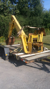 fairly large older backhoe first 1000 takes it