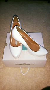 Brand new white pumps from spring