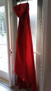 BELLE of the BALL! Youll look AMAZING in this Stunning Red Gown!