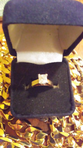 1.03ct t.w. Princess cut diamond ring replacement value 6900.00