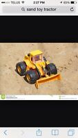 In search of sand toys: tractors, dump trucks, ect