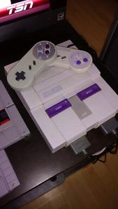 Super Nintendo avec 2 manettes + jeux / 2 remotes +  games