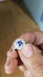 White gold ring with Tanzanite gem and diamond accents.