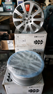 A BRAND NEW SET OF 4 ALLOY RIMS