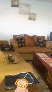 Futon two and three seat sofa with two corners tables and center