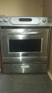 WOODEN SHLEVES/KITCHENAID STOVE/DOORS WITH LOCKS