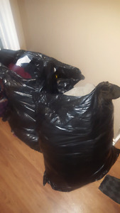 Large garbage bags of assorted clothing
