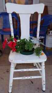 Distressed chair with plant