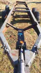 Surge brake equipped dual axle 21ft trailer frame.