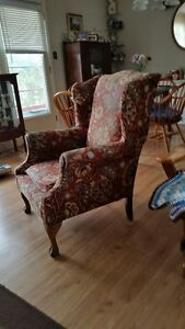 Antique wing chair with claw legs