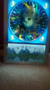 Beautiful wolf clock that lights up..please message for video