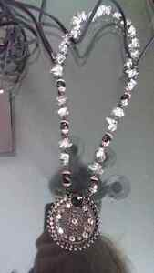 New bebe necklace