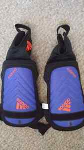 Boys soccer cleats and chin pads Kitchener / Waterloo Kitchener Area image 1