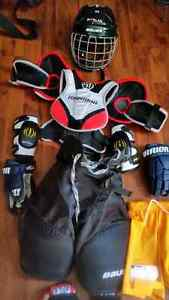 Full set of boys hockey equipment with size 1 Bauer Vapour skate