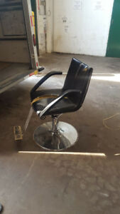 chair with working hydraulics, needs slight repair for rip