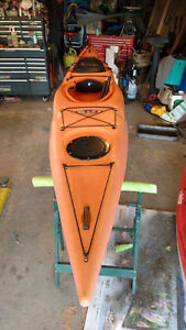 13 ft sea kayak with paddle and life jacket