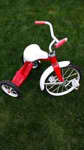 Girl or boy red tricycle