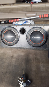 Two 10inch Pioneer subs with Boss chaso 850watt amp