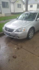 Looking to trade my altima 2.5 2004