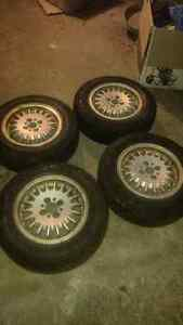 Like new 185/70r14 winter tires on 4x100 wheels.