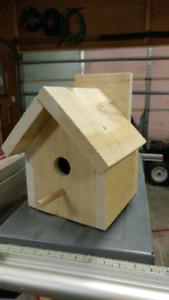 Homemade bird houses and dog houses