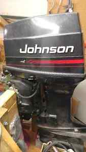 70 hp Johnson Outboard, motor and mini cape boat
