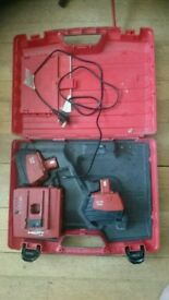 Hilti charger and four batteries