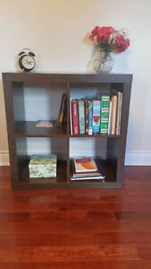 Two IKEA Kallax shelving units in 2x2 and 2x4 feet