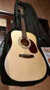 Cort acoustic guitar with case, tuner and capo
