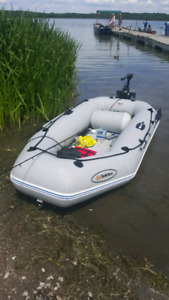 Inflatable boat with motor and battery
