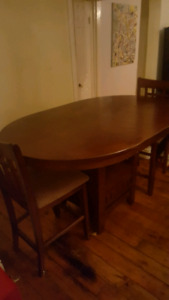 Solid wood pub height table with leaf insert and two chairs $250