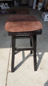 wooden stool comes with seat pad.