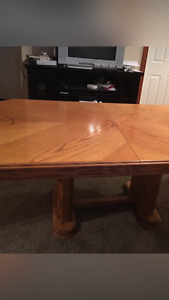 Solid wood dinning room table with leaf