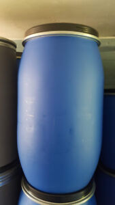 Large clean plastic barrels perfect for shipping or storage