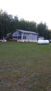 112 Acres with cabin and outbuildings