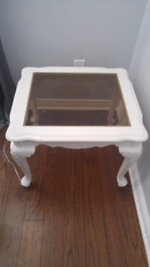 2 white wooden glass top side tables.