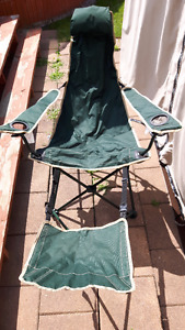 Green folding lawn chair / Lounger with footrest.