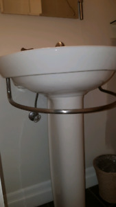 Pedestal sink with built in towel rack and faucet