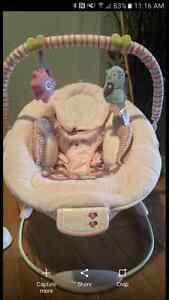 BRAND NEW - baby girls vibrating chair.