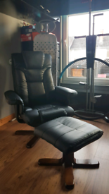 Black Reclining Faux Leather armchair and foot stool Julian Bowen