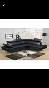 Black sectional couch (new floor model)
