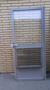 Jalousie Louver Screened Storm doors for sale.