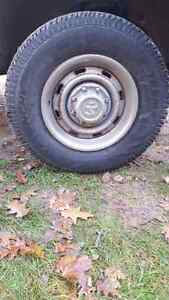 Dodge 8 bolt rims and snow tires London Ontario image 1