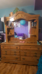 Large solid wood dresser make an offer