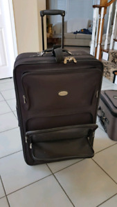 Two pieces of large rolling luggage • $20 EACH PIECE