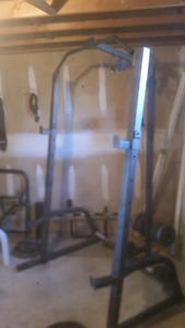 Squat rack/bench press with cables