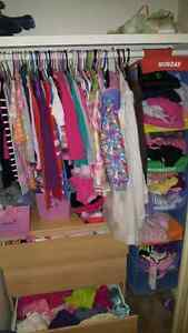 Lots of girls clothes.