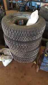 4 like new 215 70 16 used snow tires with rims